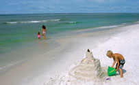 Child building sandcastle on Mexico Beach Florida
